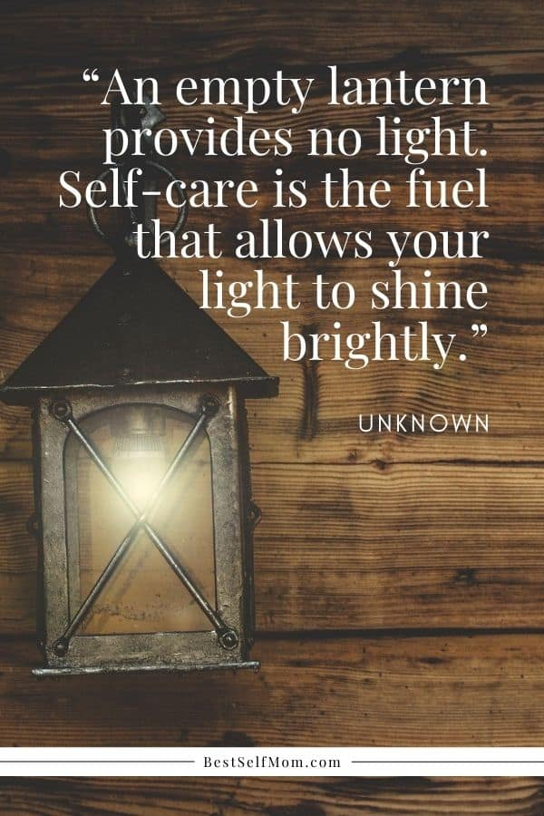 Self-care quote for busy moms over wood plank background and old fashioned lit lantern.