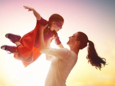 Mom raising child into the air