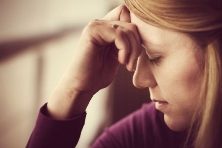 Stressed mom deep in negative thought process
